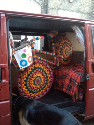 knitted bike travels by camper van